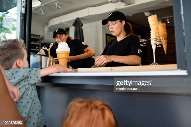 Customer service in artisanal ice cream parlor.
