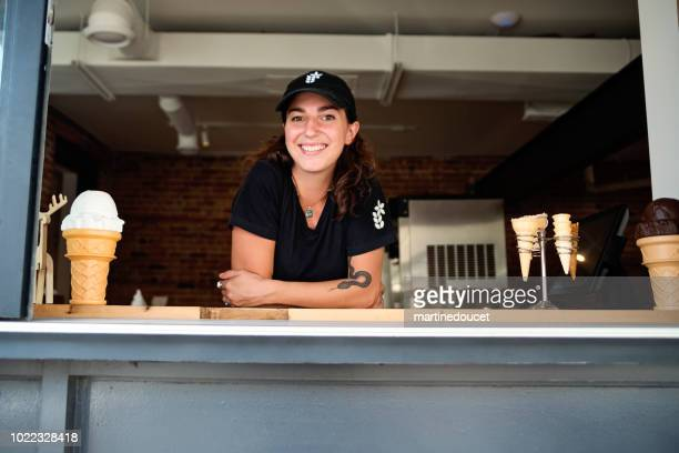"""customer service in artisanal ice cream parlor. - """"martine doucet"""" or martinedoucet stock pictures, royalty-free photos & images"""