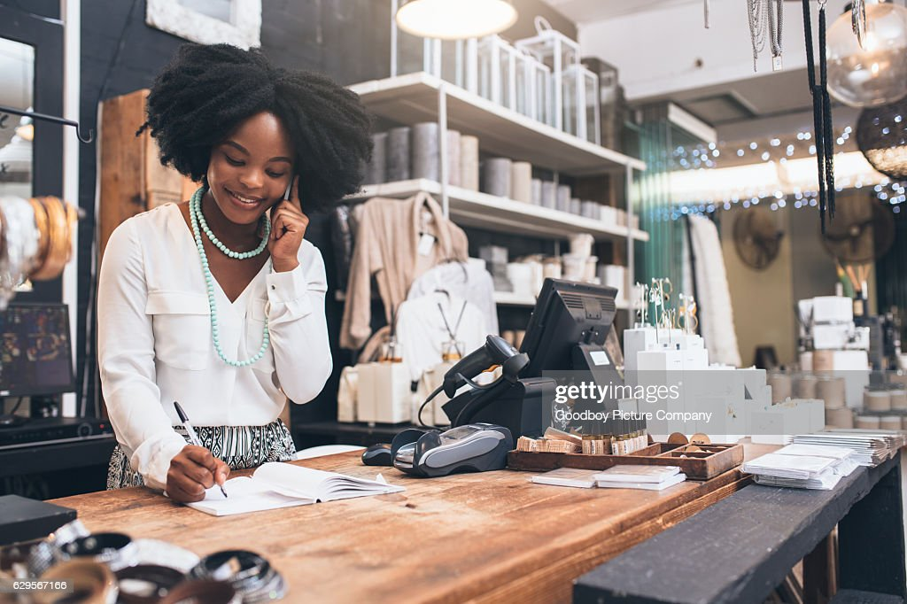 Customer service is her speciality : Stock Photo