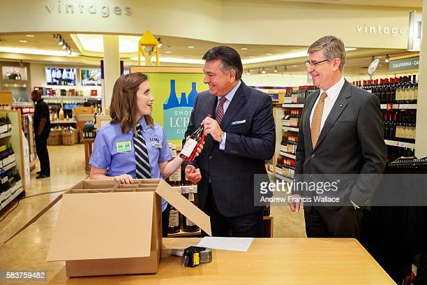 TORONTO ON JULY 26 LCBO customer service representative Elsbeth Lumley packs products for shipping with Finance Minister Charles Sousa and LCBO...