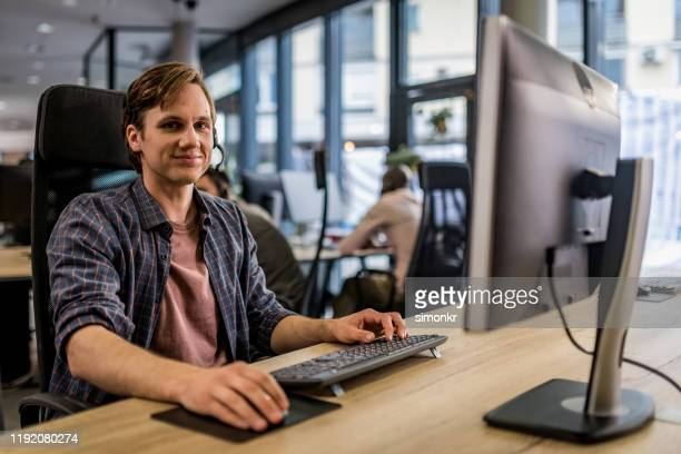 customer service representative sitting in call centre - fully unbuttoned stock pictures, royalty-free photos & images