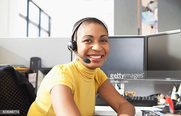 customer service representative wearing a telephone headset - customer service representative stock pictures, royalty-free photos & images