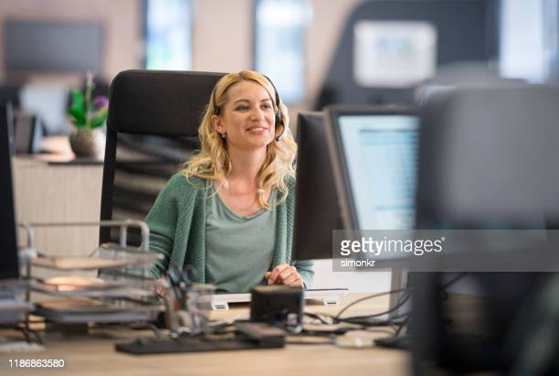 customer service representative working in call centre - outbox filing tray stock pictures, royalty-free photos & images