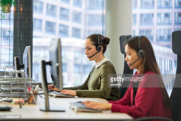 customer service representative working in call centre - outsourcing stock pictures, royalty-free photos & images