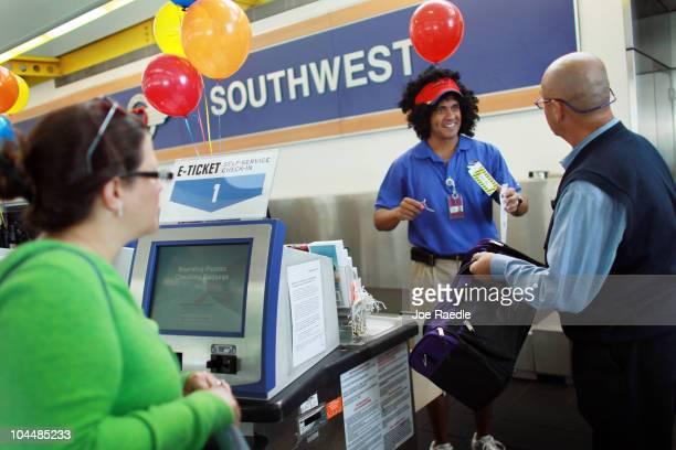 Customer service representatives Hector Sanchez and Carlos Juanchuto checkin a customer at the Southwest counter at the Fort LauderdaleHollywood...