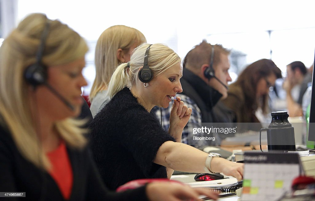 Customer service representatives take calls inside the customer service call center at First Direct bank, the online and telephone banking unit of HSBC Holdings Plc, in Leeds, U.K., on Wednesday, Feb. 26, 2014. HSBC Holdings Plc, Europe's largest bank, posted full-year profit that missed analyst estimates as a cost-cutting drive fell short of targets and revenue shrank. Photographer: Chris Ratcliffe/Bloomberg via Getty Images