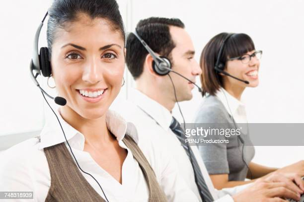 Customer service representatives wearing headsets