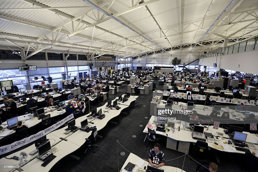 Customer service representatives work at their desks inside the customer service call center at First Direct bank, the online and telephone banking unit of HSBC Holdings Plc, in Leeds, U.K., on Wednesday, Feb. 26, 2014. HSBC Holdings Plc, Europe's largest bank, posted full-year profit that missed analyst estimates as a cost-cutting drive fell short of targets and revenue shrank. Photographer: Chris Ratcliffe/Bloomberg via Getty Images