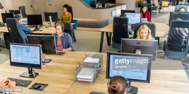 customer service representatives working in call centre - outsourcing stock pictures, royalty-free photos & images