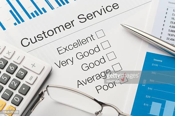 Customer service survey, a pen, and adding machine
