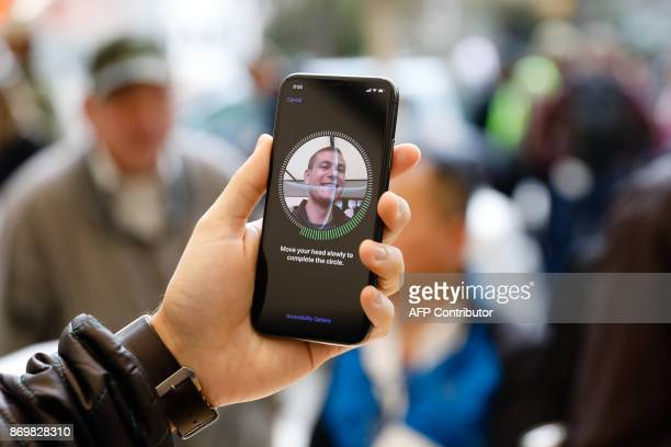 A customer sets up Face ID on his new iPhone X at the Apple Store Union Square on November 3 in San Francisco California Apple's flagship iPhone X...