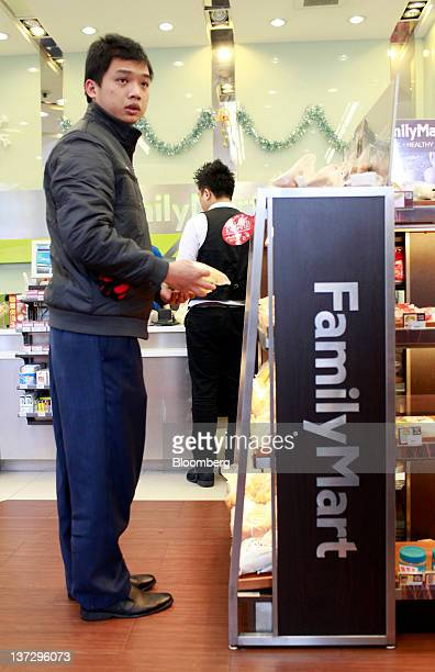 A customer shops at a FamilyMart Co convenience store in Shanghai China on Sunday Jan 15 2012 FamilyMart Co Japan's largest convenience store...