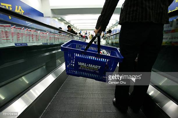 A customer shops at a newly opened WalMart supercenter October 14 2006 in Beijing China WalMart workers in China have set up unions at all 62 Chinese...