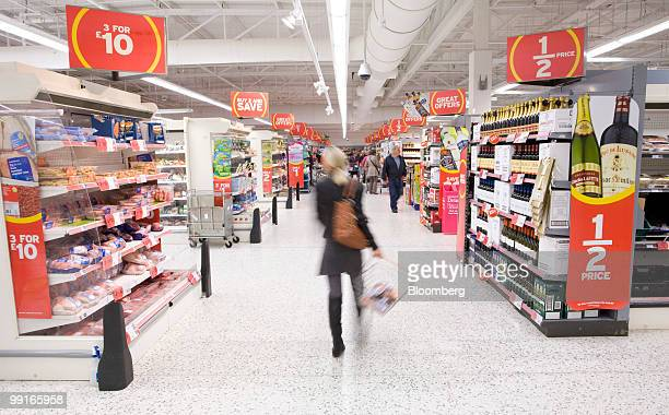 A customer shops at a Sainsbury's supermarket in Chafford Hundred UK on Wednesday May 12 2010 The UK's third largest supermarket chain said profit...
