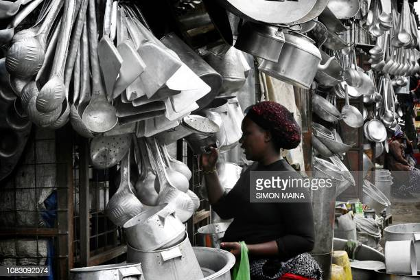 A customer shops at Jua Kali artisan market that makes house hold items in Gikomba Market in Nairobi Kenya January 15 2019 An estimated 831 per cent...