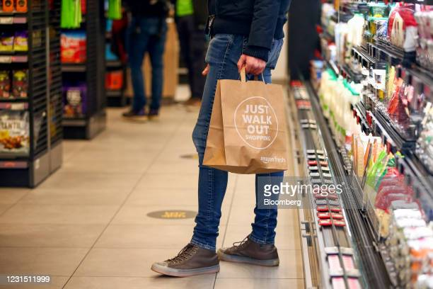 Customer shops at the Amazon.com Inc. Amazon Fresh cashierless convenience store in the Ealing area of London, U.K., on Thursday, March 4, 2021. The...