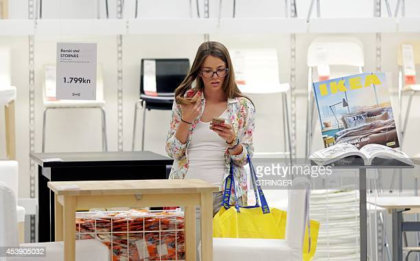 A customer shops at the newly opened IKEA store near Zagreb on August 21 2014 Swedish furniture giant IKEA opened its first store in the territory of...