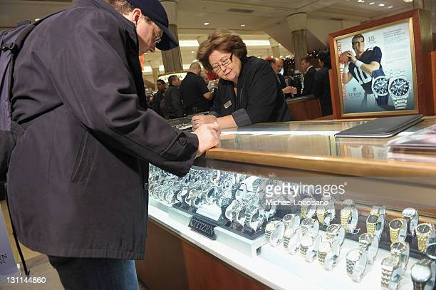 A customer shops Citizen Watchies durting the introduction by Eli Manning of his Limited Edition CITIZEN EcoDrive Watch at Macy's Herald Square on...