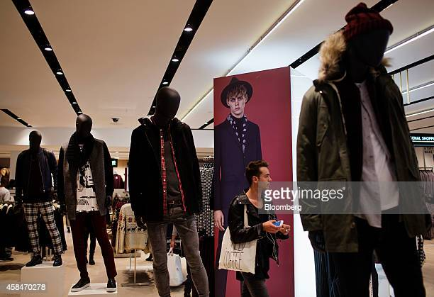 A customer shops during the grand opening of the Topshop Topman flagship store in New York US on Wednesday Nov 5 2014 Beyonce has struck up a...