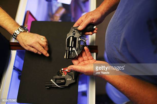 A customer shops for a handgun at the KW Gunworks store on the day that US President Barack Obama in Washington DC announced his executive action on...