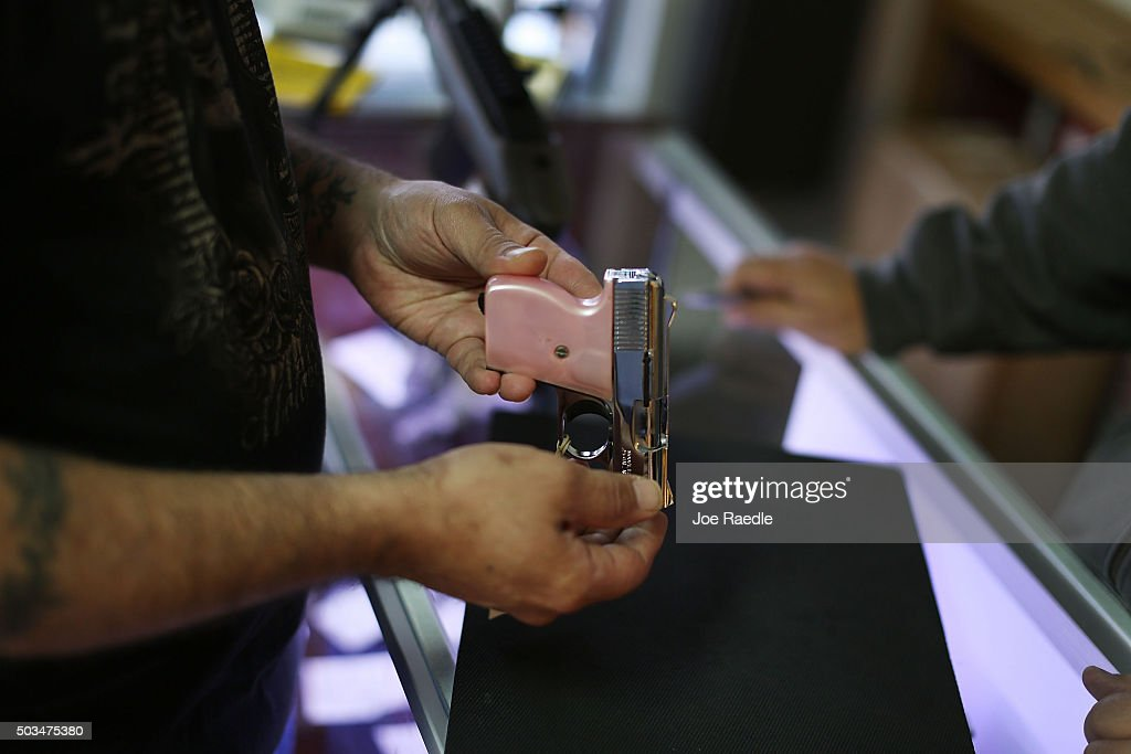 A customer shops for a handgun at the K&W Gunworks store on the day that U.S. President Barack Obama in Washington, DC announced his executive action on guns on January 5, 2016 in Delray Beach, Florida. President Obama announced several measures that he says are intended to advance his gun safety agenda.