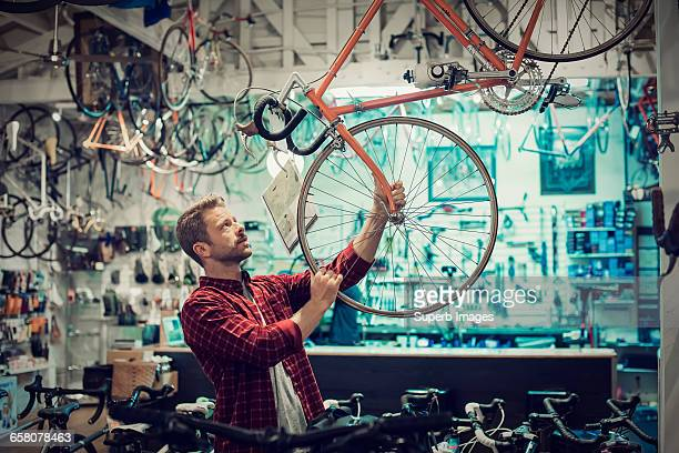 customer shops for bike - wheel stock pictures, royalty-free photos & images