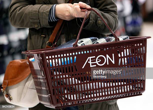 A customer shops for clothes during a discount sale at Aeon Co's Jusco store in the Aeon Lake Town shopping mall in Koshigaya City Saitama Prefecture...