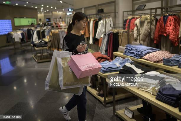 A customer shops for clothing at a mall in Beijing on January 16 2019 China's GDP growth may be significantly slower than official estimates suggest...