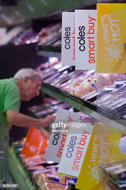 A customer shops for cuts of meat at a Coles Group Ltd supermarket in Sydney Australia on Wednesday May 16 2007 Coles Group Ltd targeted for a...