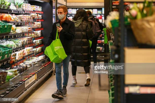 Customer shops for fresh vegetables at the Amazon.com Inc. Amazon Fresh cashierless convenience store in the Ealing area of London, U.K., on...