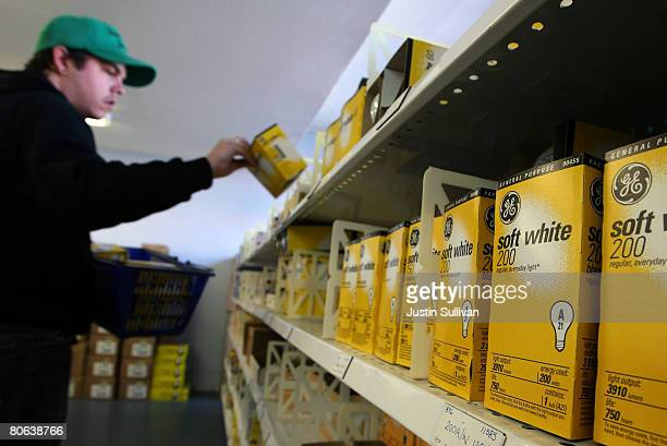 A customer shops for General Electric light bulbs at City Lights lighting store April 11 2008 in San Francisco California General Electric reported...
