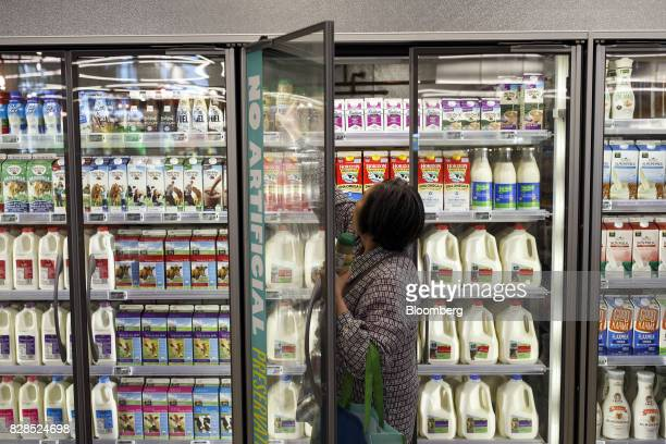A customer shops for milk during the grand opening of a Whole Foods Market 365 location in Santa Monica California US on Wednesday Aug 9 2017 The...