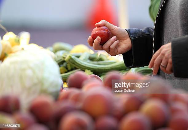 A customer shops for nectarines at a farmers market on June 13 2012 in San Francisco California The US Senate has started to debate the new fiveyear...