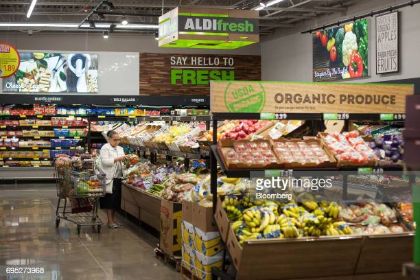 A customer shops for organic produce at an Aldi Stores Ltd location in Hackensack New Jersey US on Thursday June 8 2017 A decadeslong supermarket...