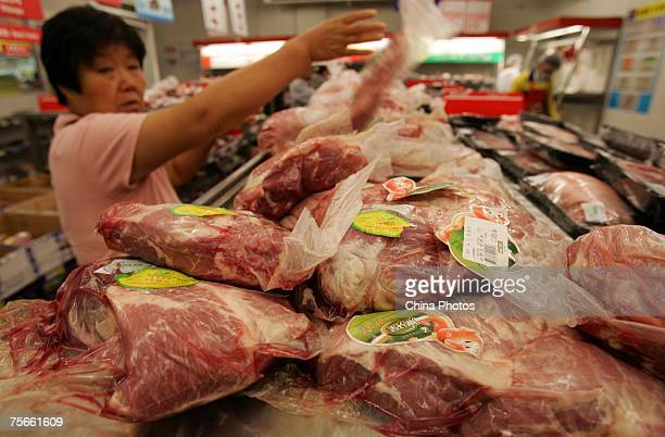 A customer shops for pork at a supermarket on July 25 2007 in Beijing China Beijing recently announced it will start a daily report system on food...