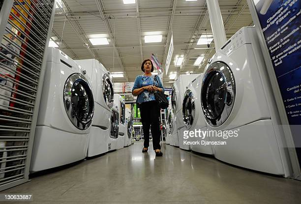 A customer shops for washers and dryers at Lowe's October 27 2011 in Burbank California Spending on durable goods and cars helped boost third quarter...
