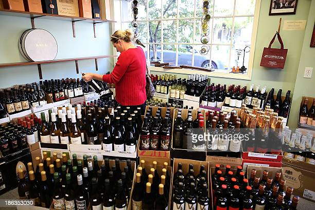A customer shops for wine at Ludwigs Fine Wine and Spirits on October 30 2013 in San Anselmo California According to a report released by Morgan...