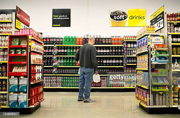 A customer shops in the soda aisle of a Dollar General Corp store in Saddle Brook New Jersey US on Saturday Dec 3 2011 Dollar General is scheduled to...