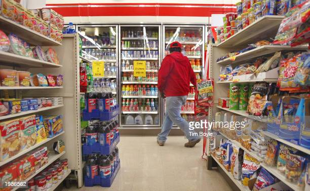 A customer shops inside a 7Eleven store May 9 2003 in Des Plaines Illinois Dallas Texasbased 7Eleven Inc the world's largest convenience store...