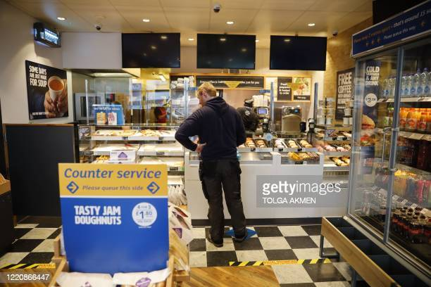 Customer shops inside a reopned Greggs bakery in London on June 18, 2020 after the chain reopened hundreds of stores around the UK following their...