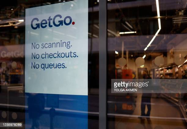 Customer shops inside supermarket chain Tesco's first check-out free food store in Holborn, central London, on October 19, 2021. - Britain's biggest...