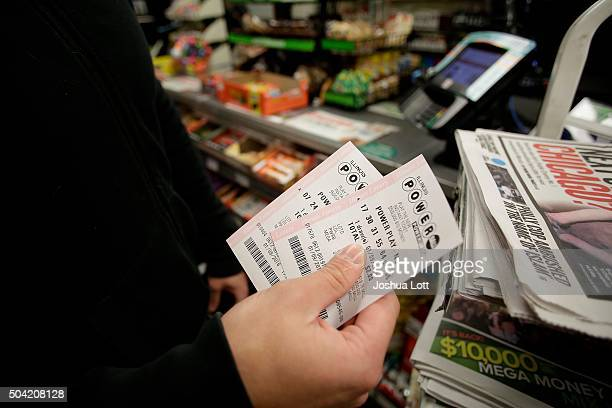 A customer shows off his Powerball tickets at a 7Eleven store January 9 2016 in Chicago Illinois The Powerball Jackpot Surged to a record $900...