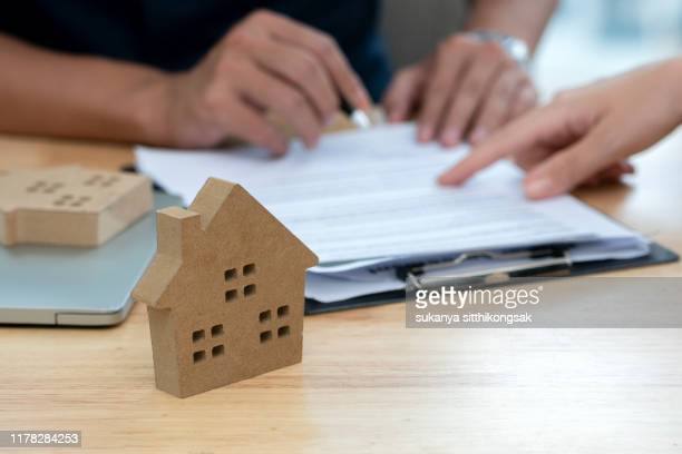 customer signing a real estate contract in real estate agency. - agreement stock pictures, royalty-free photos & images