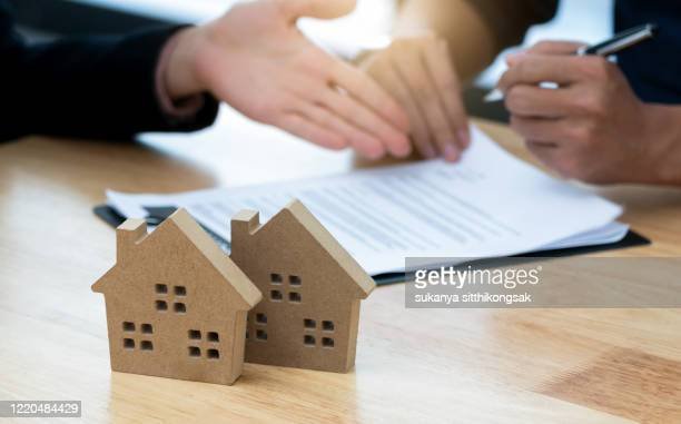 customer signing a real estate contract in real estate agency.concept mortgage,home purchase contract. - stock trader stock pictures, royalty-free photos & images