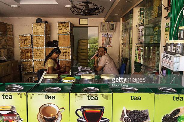 A customer sits as a storekeeper speaks on the phone at a tea store in Siliguri West Bengal India on Tuesday Dec 8 2015 India has a $48 billion...