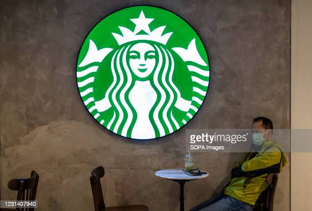 Customer sits at the American multinational chain, Starbucks Coffee store seen in Hong Kong.