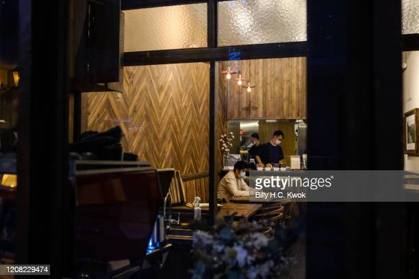 A customer sits in a restaurant during a coronavirus outbreak on March 26 2020 in Hong Kong China Latest statistics showed Hong Kong tourist arrivals...