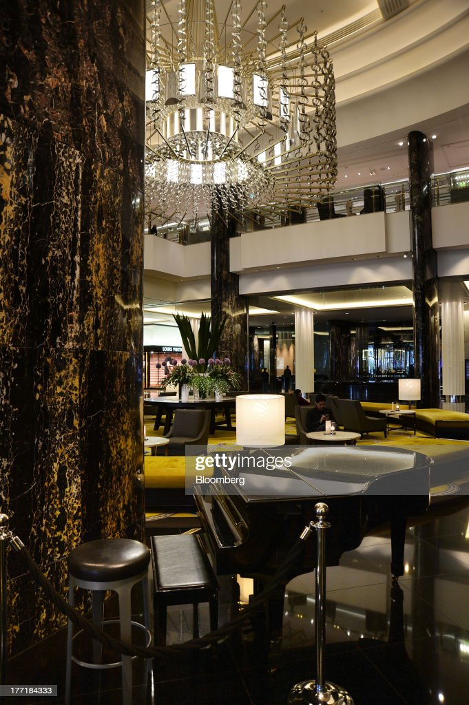 A customer sits in the lobby area of the Crown Towers hotel, part of the Crown Melbourne casino and entertainment complex operated by Crown Ltd., in Melbourne, Australia, on Wednesday, Aug. 21, 2013. Crown Ltd., the gaming company controlled by billionaire James Packer, is scheduled to announce full-year results on Aug. 23. Photographer: Carla Gottgens/Bloomberg via Getty Images