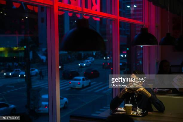 A customer sits inside a Burger King do Brasil restaurant on Paulista Avenue in Sao Paulo Brazil on Monday Dec 11 2017 Burger King do Brasil may...