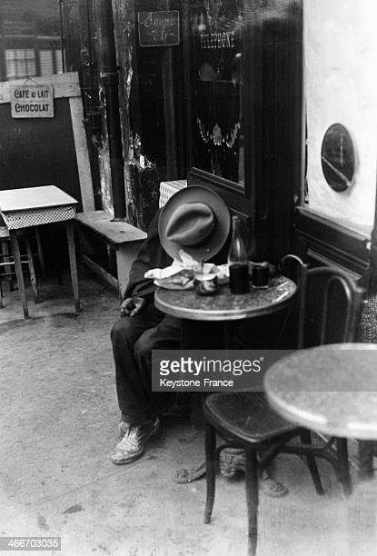 A customer sleeping on the table of a cafe in October 1929 in Paris France